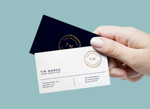 200 best business card mock ups for free download 2018 edition hand holding business cards mockup reheart Images